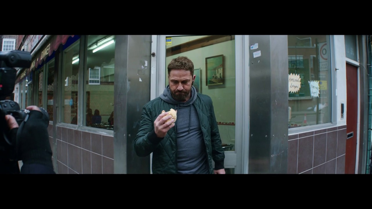 Gerard Butler Runs From Paparazzi In This Action-Packed Ad!