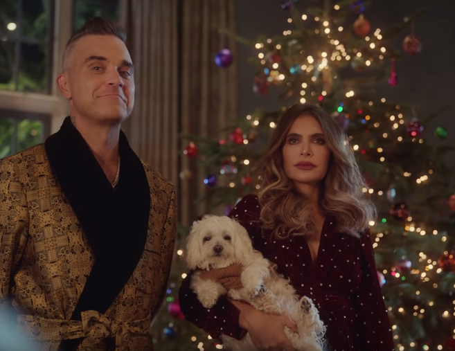 "Robbie Williams Released This Christmassy Music Video For ""Time For Change"""