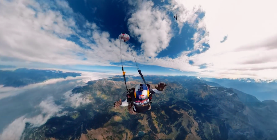 Watch Red Bull's Wing Suit Team Fly Around The Swiss Alps